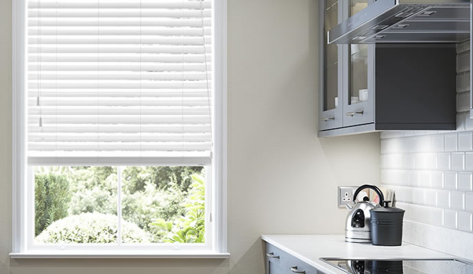 White Wood Blinds In Kitchen